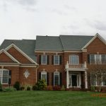 roofing before brick house front view